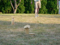 kubb game in action