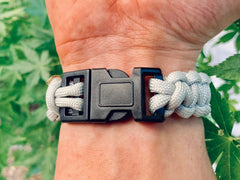 Wearing a gray paracord bracelet