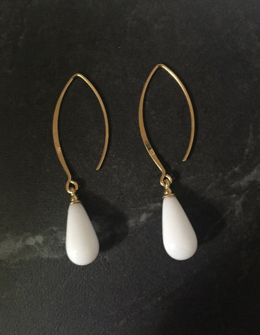 Glass milk & gold long drop earrings