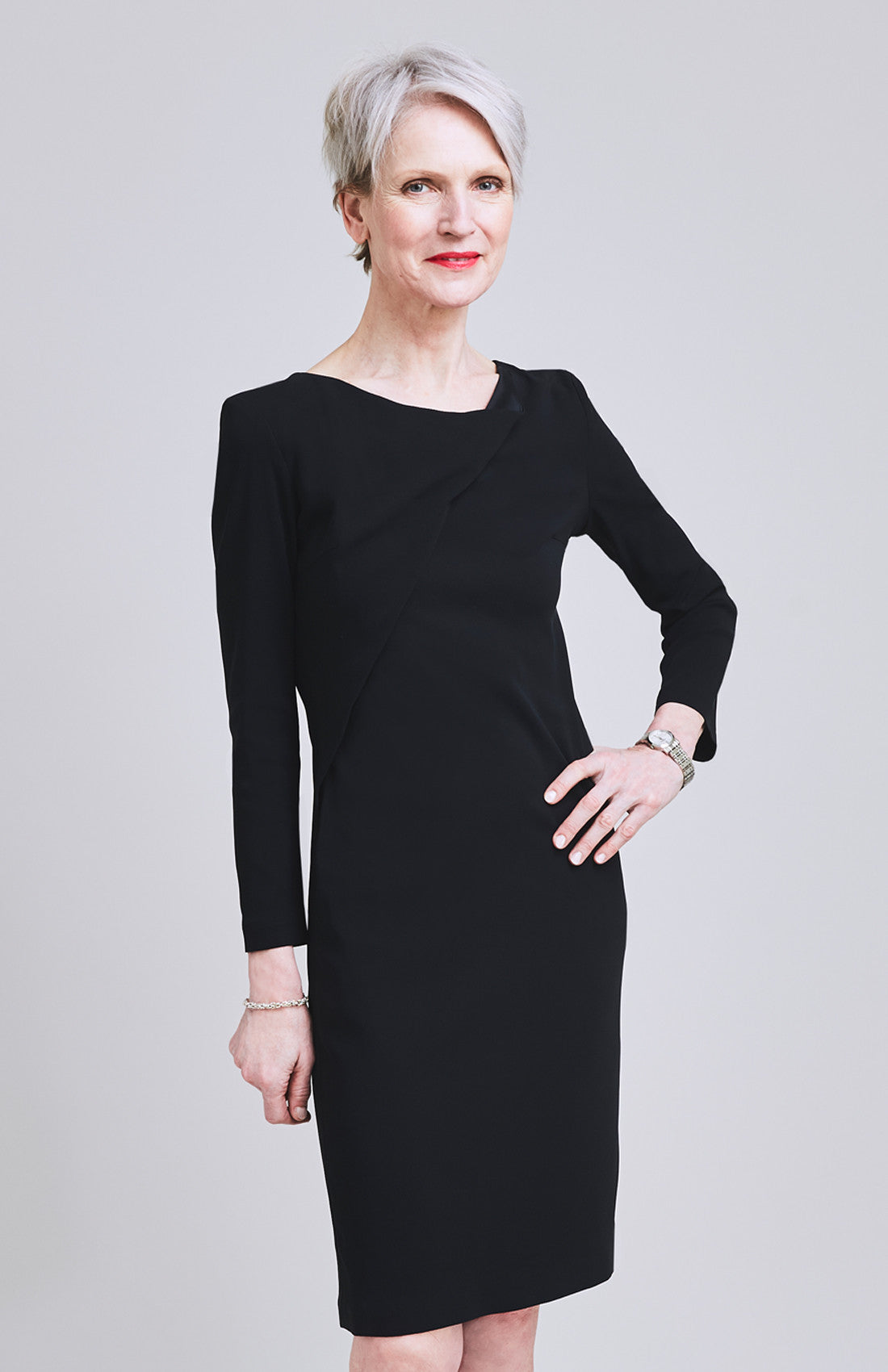 Black office shift dress with long sleeves and twist neckline
