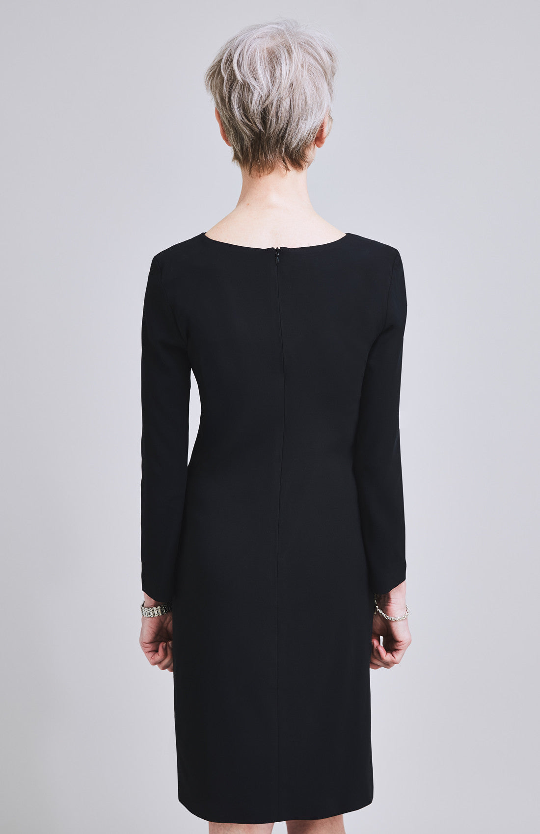 Long sleeve knee length office shift dress with twist neckline black