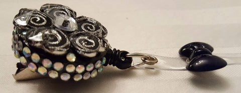 Bedazzled Black and Silver Spiral Badge