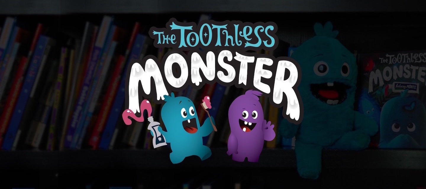 The Toothless Monster logo with blue and purple monsters. Friends of the tooth fairy.
