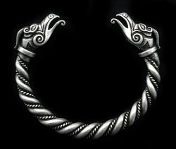 Enjoy this large trendy Men's 2 3/4 inch diameter handmade antique silver plated Norse Viking bracelet featuring an intricate twist and dragon head figures at both ends. Based on silver ones from the Viking age it is made of a durable pewter type zinc alloy that will stand up to all your Viking activities. The bracelet can be adjusted by warming in the sun and taking on and off. Makes a great gift for you or your Viking loving mate.