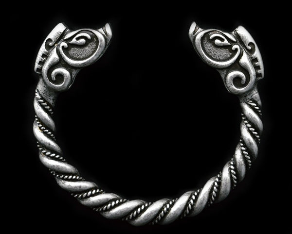 Enjoy this large trendy Men's 2 3/4 inch diameter handmade antique silver plated Norse Viking bracelet featuring an intricate twist and wild boar head figures at the ends. Based on silver ones from the Viking age it is made of a durable pewter type zinc alloy that will stand up to all your Viking activities. The bracelet can be adjusted by warming in the sun and taking on and off. Makes a great gift for you or your Viking loving mate.