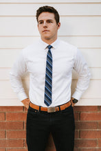 Load image into Gallery viewer, man in camel belt and grey and navy striped tie
