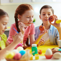 painting eggs at easter