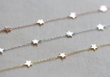 Six tiny little stars hang alongdelicate chain. Works great layered with other bracelets or all alone. Details:  6 inches long with 2 inch extender 14kt gold