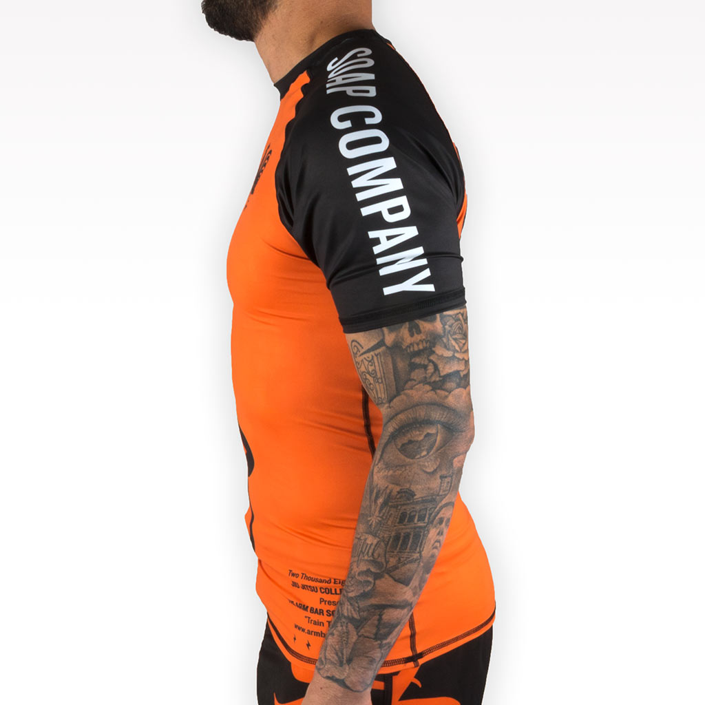 The Official Issue Short Sleeve Rash Guard - ORANGE - Apparel - The Arm Bar Soap Company
