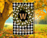 Personalized Garden Flag with Initial inside Cotton Wreath over Black Buffalo Plaid and Custom Name
