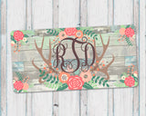 Personalized Monogram Aluminum License Plate with Floral Antlers and Faux Barn Wood Background