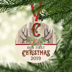 Our First Christmas with Date and Personalized Initial Ornament Faux Wood Background Rustic Antlers