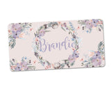 Pink and Lavender Floral Personalized Monogram Aluminum License Plate over Pink Background