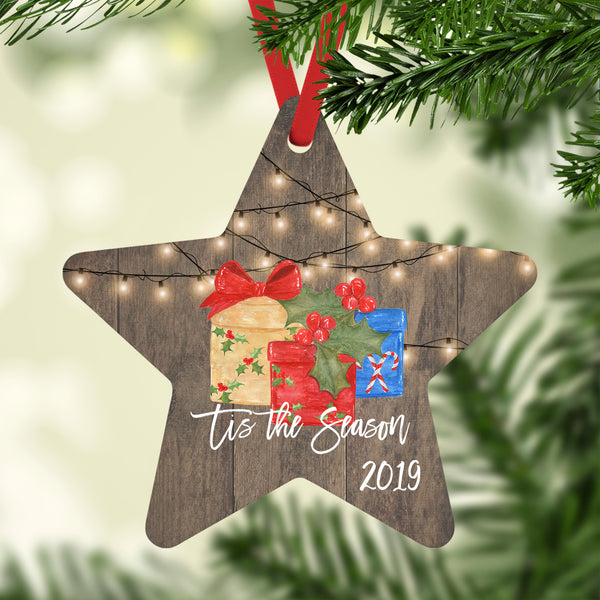 Tis the Season 2019 Christmas Ornaments String White Lights over Barnwood and Wrapped Gifts, Star