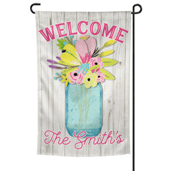 Welcome Garden Flag Personalized with Custom Family Name over Blue Mason Jar with Spring Flowers