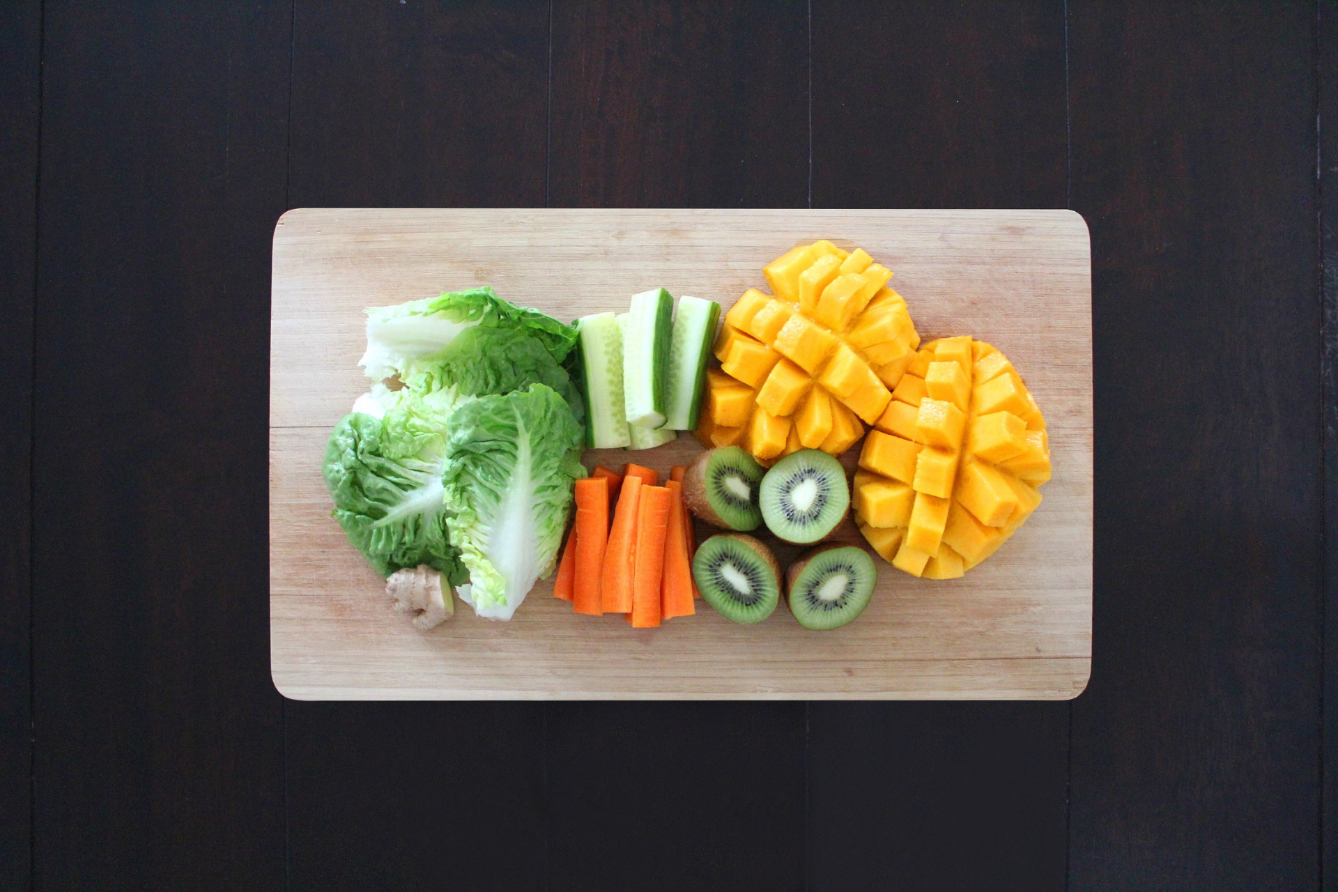A cutting board filled with fruits and vegetables.