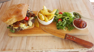 ground ostrich steak burger with fries and a salad