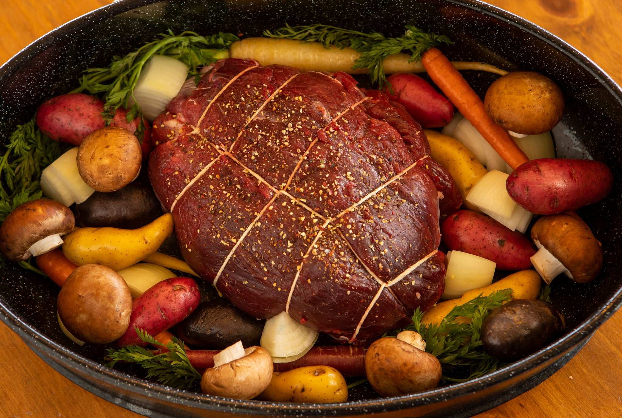 ostrich tips in pot with carrots, potatoes and mushrooms