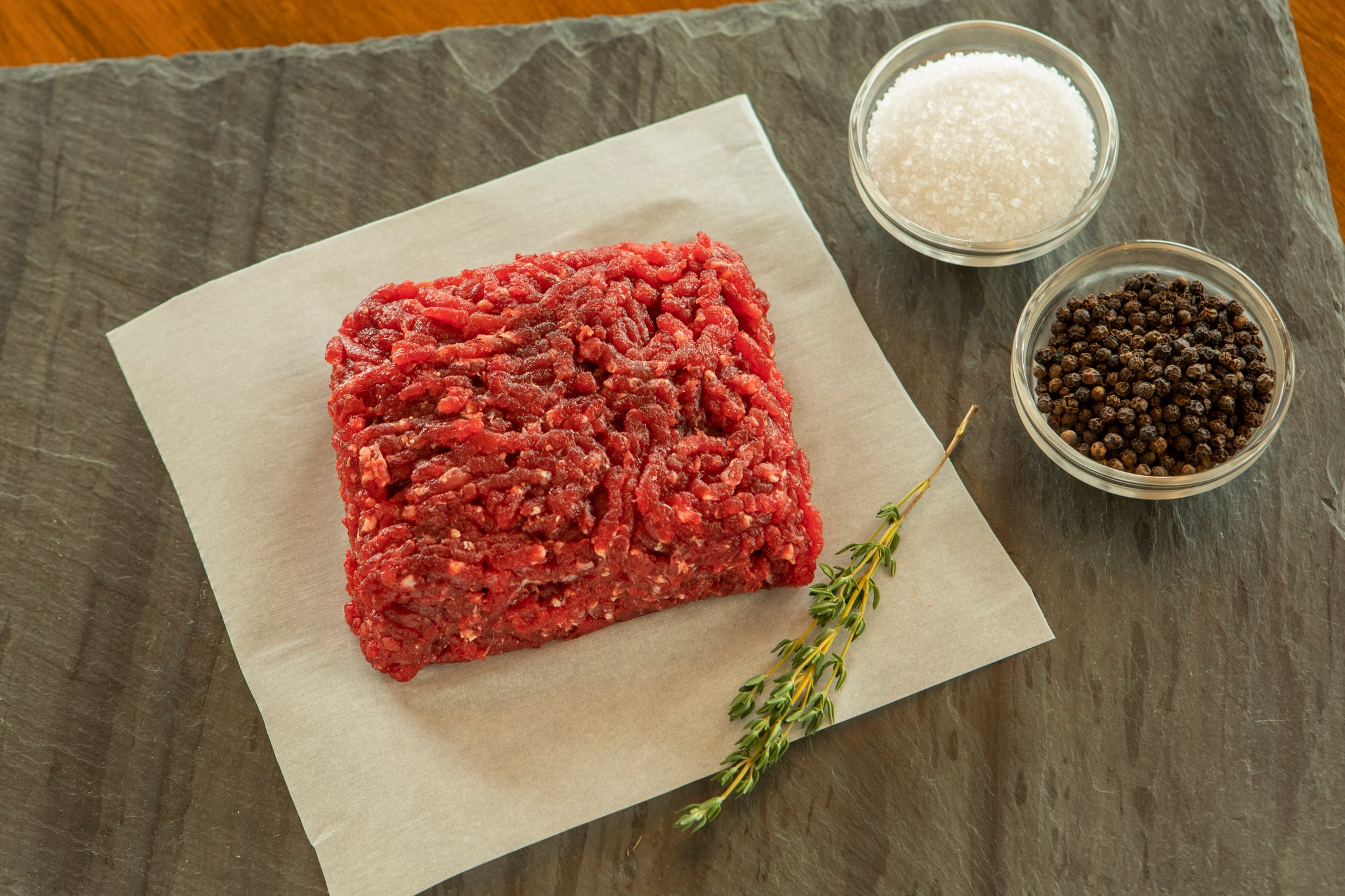 raw ground ostrich steak with salt and pepper