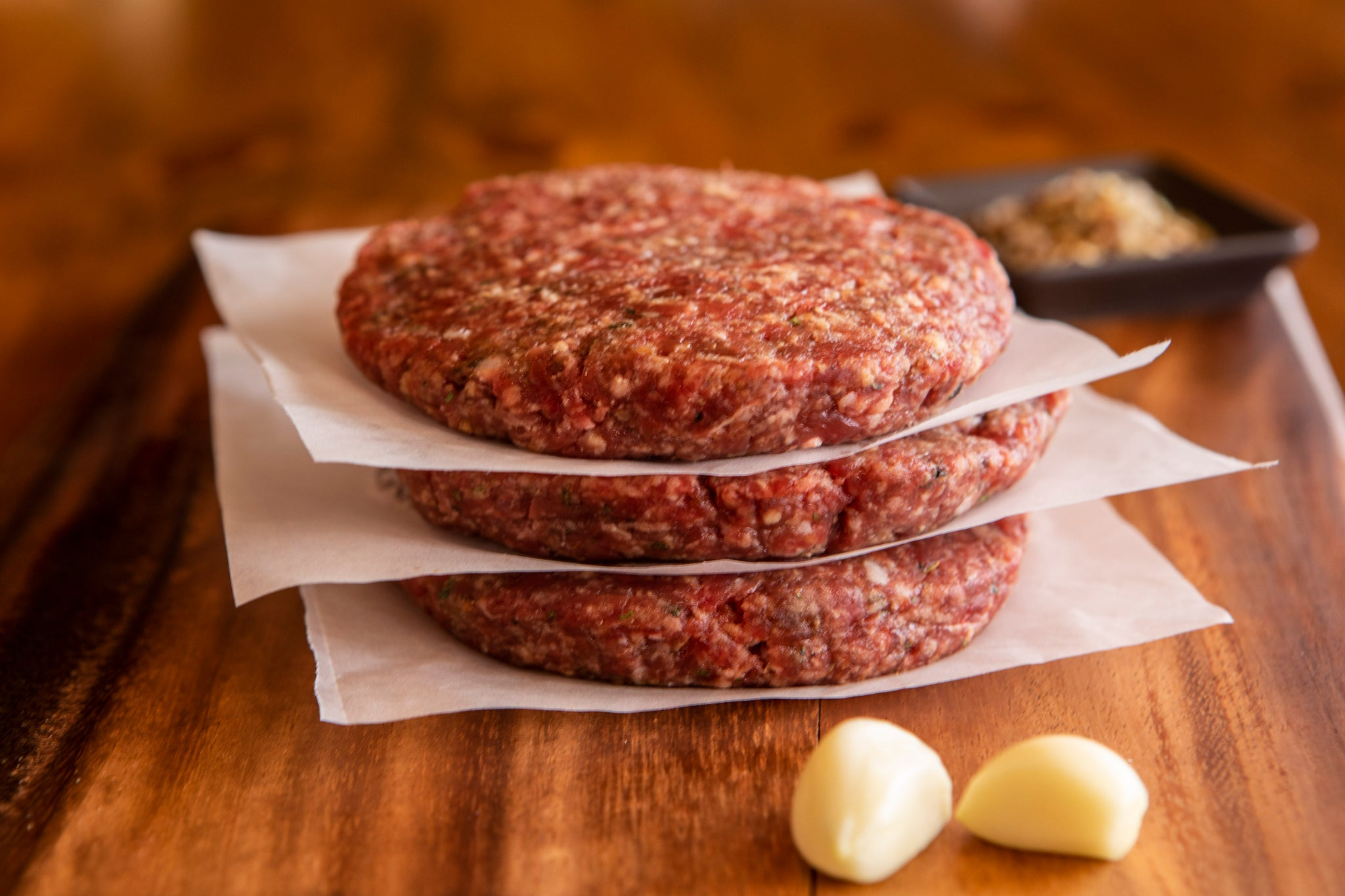 stack of 3 ground ostrich steak burgers