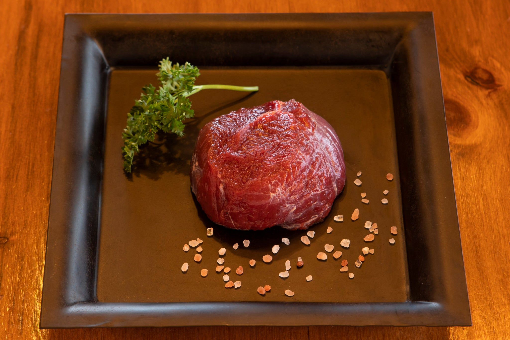raw ostrich fan filet on plate