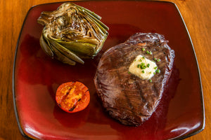 grilled ostrich inside strip with butter and artichoke on the side