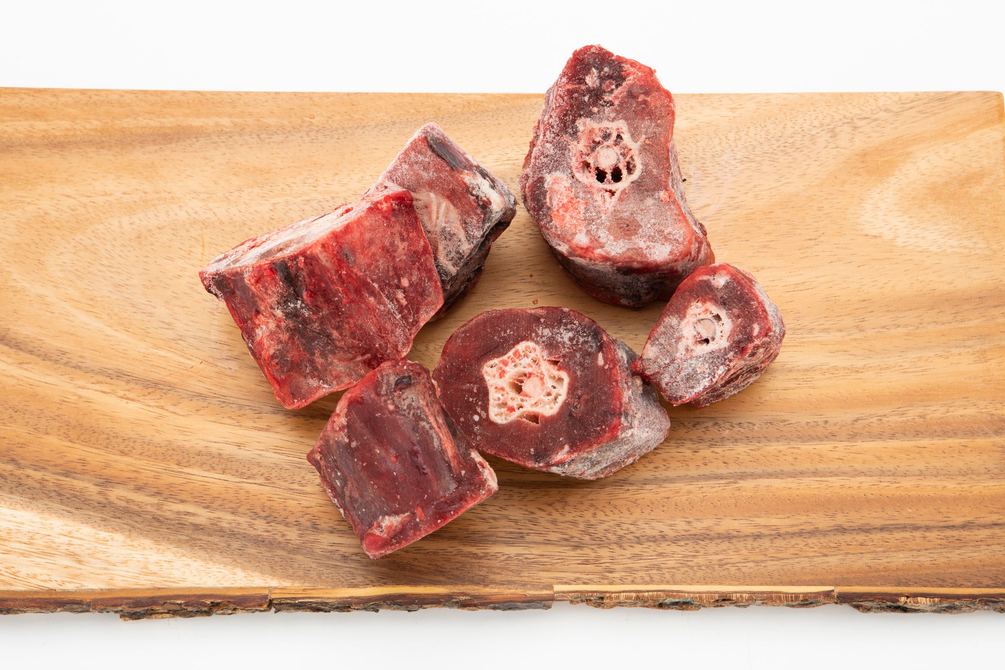5 raw ostrich necks on cutting board