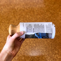 Wrap newspaper around the newspaper pot maker