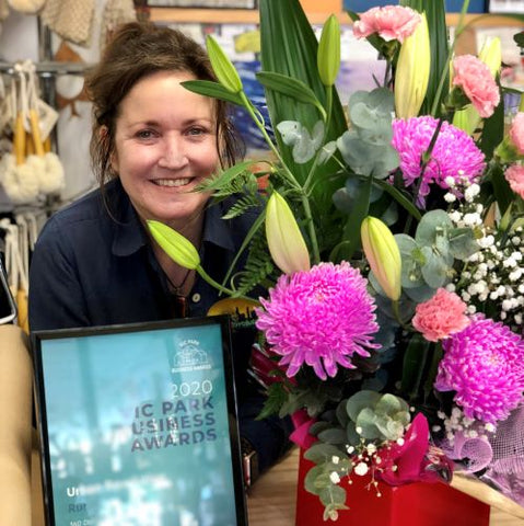 Jo with Urban Revolution's Vic Park Business Awards certificate and flowers