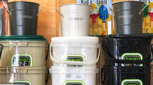 Small compost buckets sitting on top of Bokashi Kitchen Compost Systems