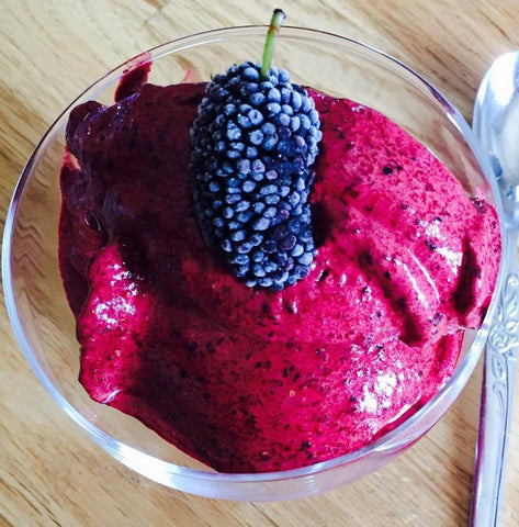 Mulberry sorbet in a glass bowl