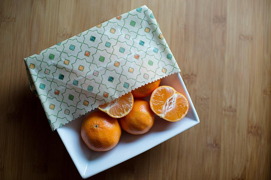 Beeswax Food Wrap Being Used to Cover Bowl of Mandarins
