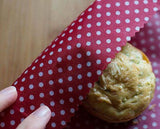 Beeswax Food Wrap Being Used to Wrap a Muffin