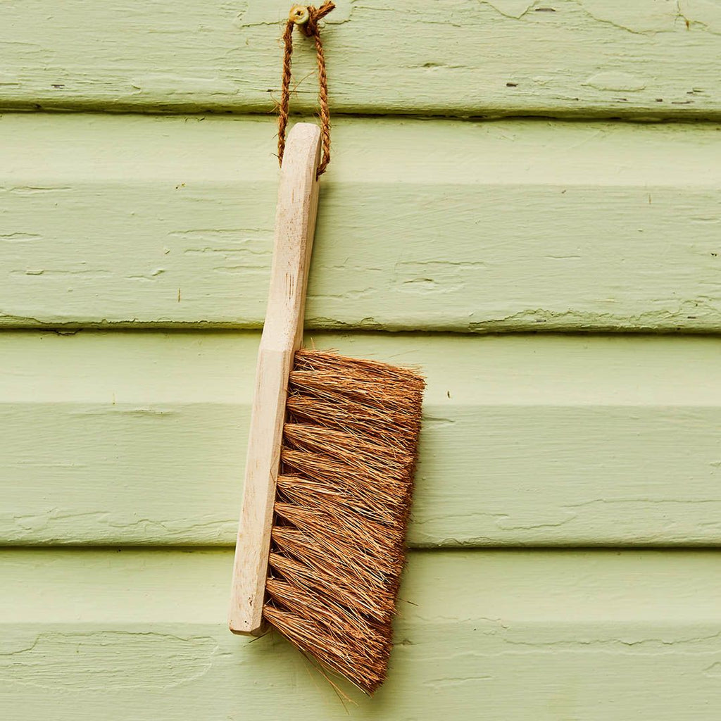 Dust Brush from Eco Max, Hanging on a Green Wall