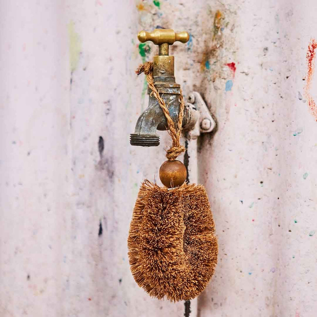 Gardeners Brush from Eco Max, Hanging on a Tap