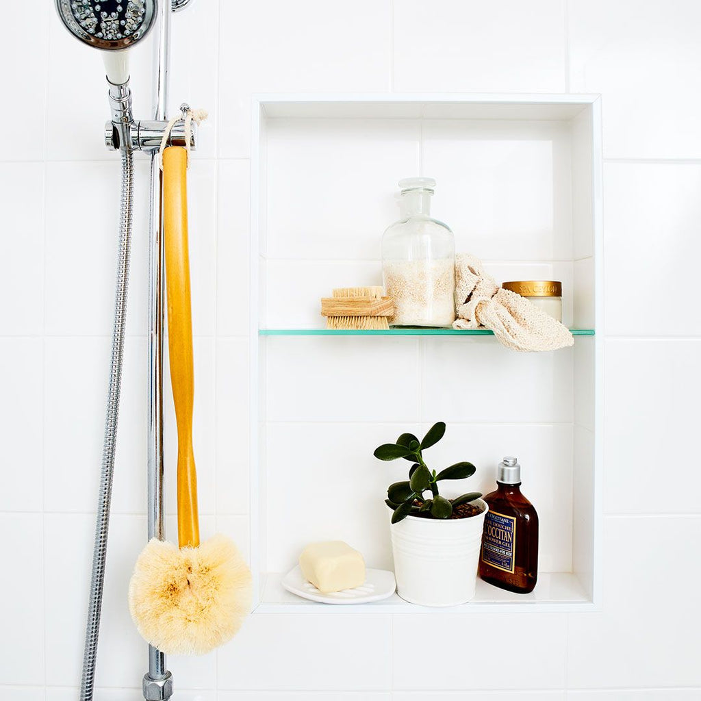Long Handled Back Brush from Eco Max, Hanging in a Bathroom
