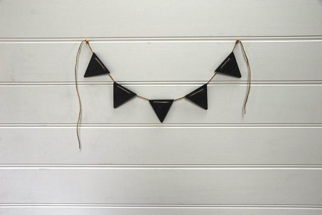 Slate Bunting on a White Wall, from Heaven In Earth