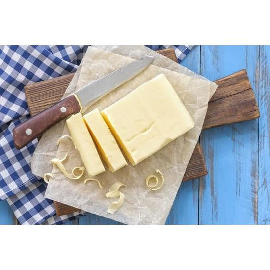 Homemade Butter on a Cutting Board with Knife