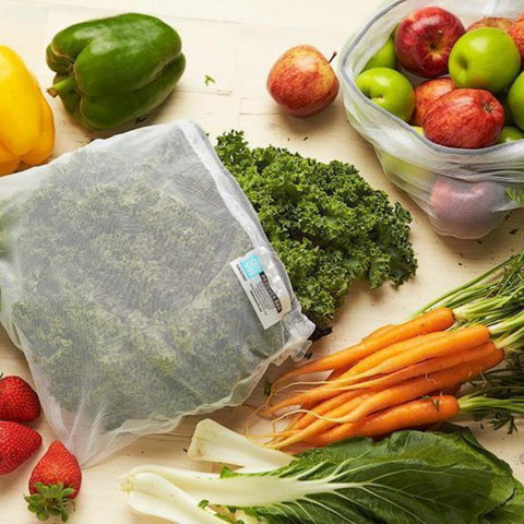 Two ONYA Produce Bags with a Variety of Vegetables and Fruits