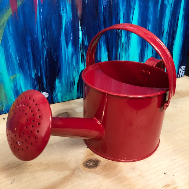 Small Red Children's Watering Can, front view.