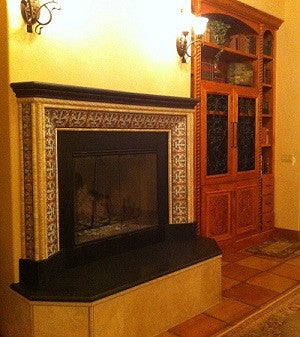 Spanish Tiles Create Border for Fireplace