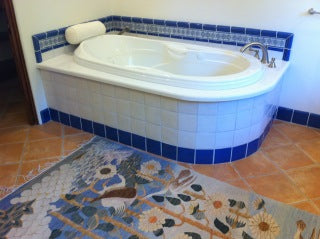 3x6 Caceres tiles are used as listello around the tub.