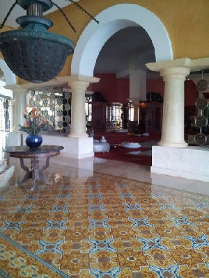 The above commercial installation of Cuban cement tile uses a classic rug design in rich, warm colors.