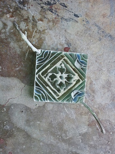 A cement tile mold acts as a blank canvas