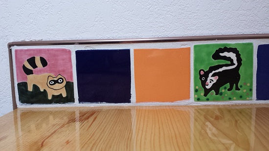 Avente's Animal Tile include a Raccoon and Skunk.