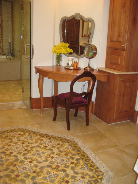 In this master bath, a cement tile rug is created using  Avente's Traditional Sosua pattern