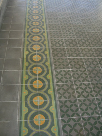 Traditional Cement Tile borders a Geometric Field Tile