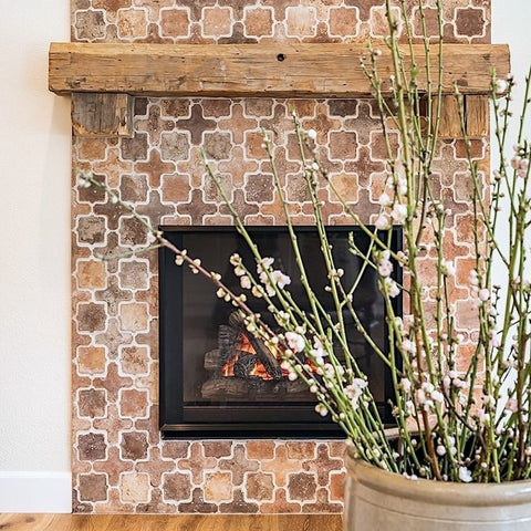 Arabesque Tangier Cement Tiles in a blend of colors and textures provide a rustic look to this hearth.