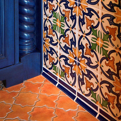 Hand-painted Spanish wall tile paired with concrete floor tile with the look of Mexican saltillo tile