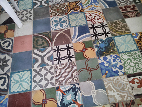 Bold, playful and colorful cement tile patchwork on a floor